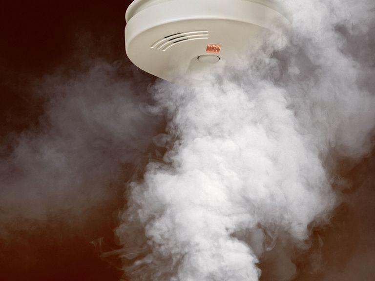 smoke rising under fire alarm