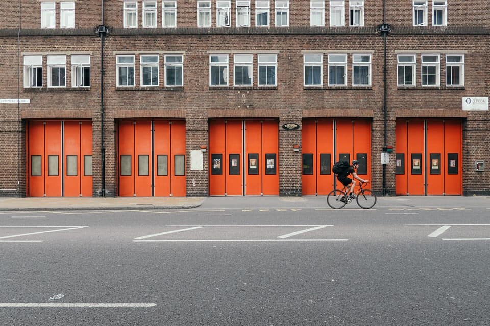 red fire station doors on london street