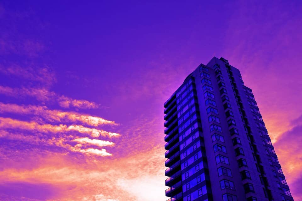 fire safety in high-rise flats with flammable cladding - tower block at sunset