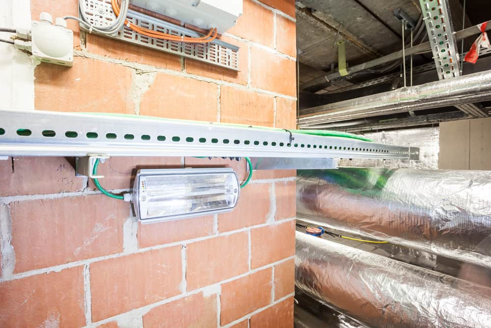 emergency lighting regulations for a fitting below a cable duct