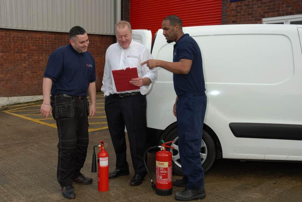 surrey fire team discussing an assessment